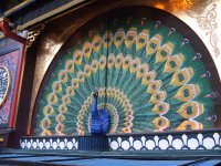 The drop curtain of The Pantomime Theatre in the Tivoli Gardens, Copenhagen with peacock subject (detailed)